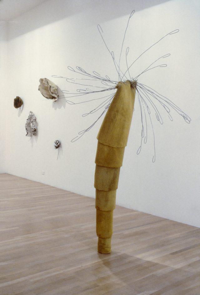 """Coatdress/ButterUp, 1996, carpet, concrete, paint, wire, 96"""" x 42"""" x 57"""""""